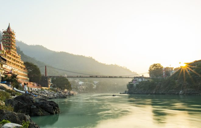 RISHIKESH - INDIA - 27 DECEMBER 2017. Spectacular view of the Lakshman Temple bathed by the sacred river Ganges at sunset. Trayambakeshwar is one of the important holy shrines in Rishikesh, Uttarakhand, India.